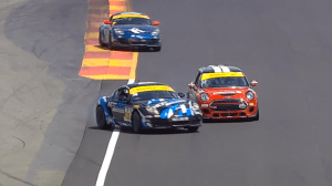 Porsche spinning out into side of 52.