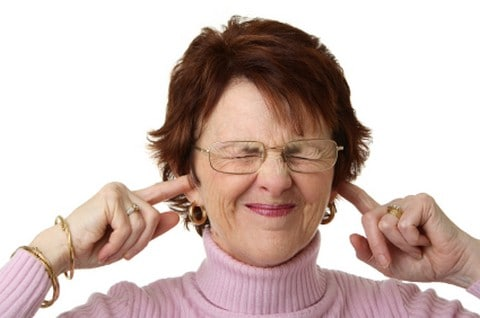 Woman teachers with fingers in her ears.