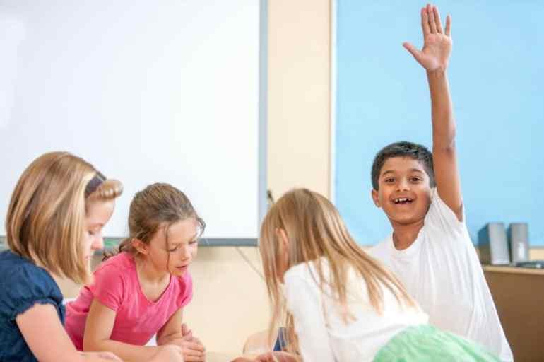 boy-raising-hand-in-classroom