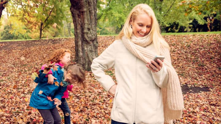 Mom on cell phone missing fun with her kids