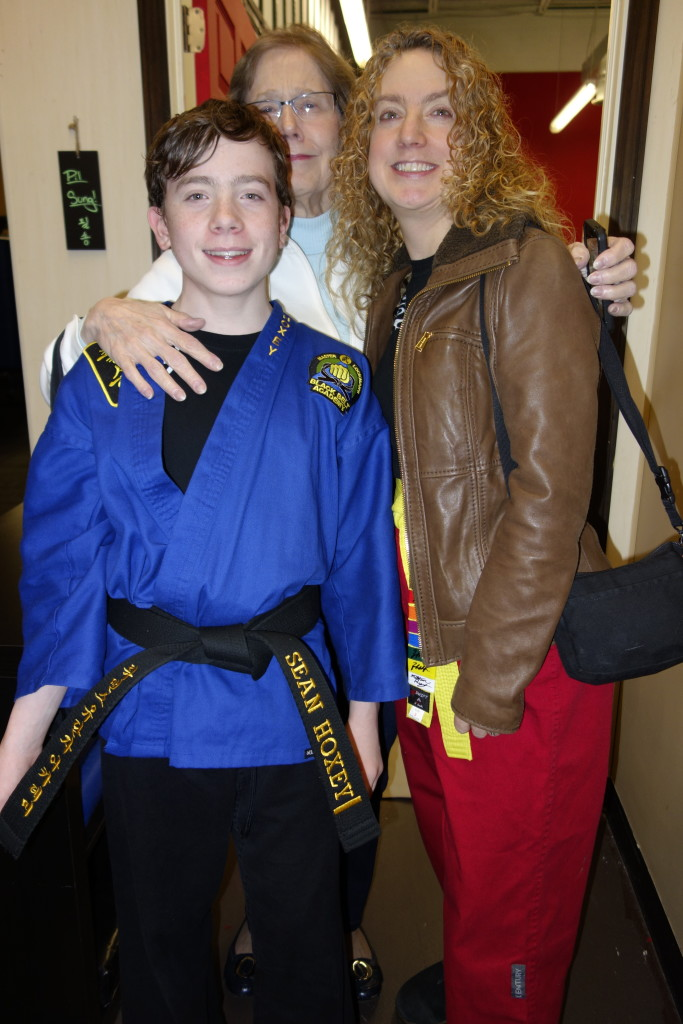 Sean Hoxey at his black belt award ceremony with Cynthia Hoxey (donning her karate outfit) and Cynthia's mother Pat