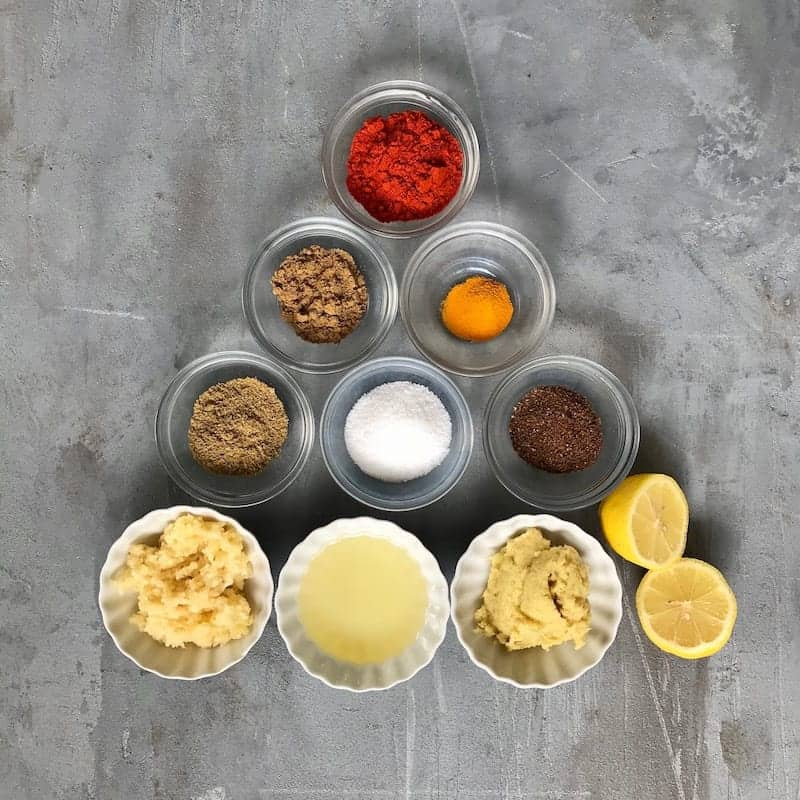 Bowls of spices lines up in a triangle shape