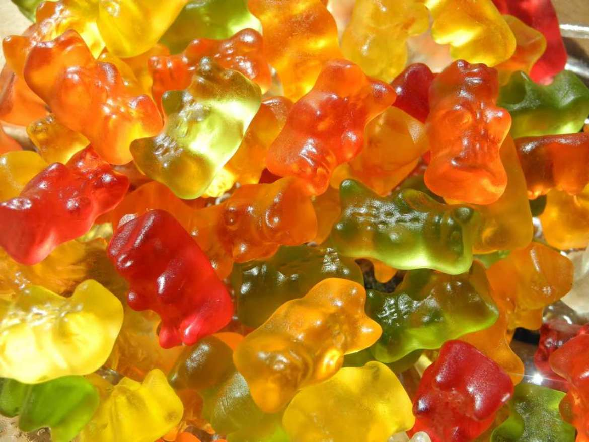 A closeup of rainbow gummy bears in a pile. Some anecdotal reports suggest CBD gummies offer longer lasting but milder effects than some other forms of CBD.