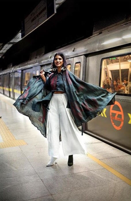 Numerous designers have already incorporated Hemp Fabric Lab into their work. Photo: A female model poses in front of a subway car in India, wearing flowing hemp fabrics.