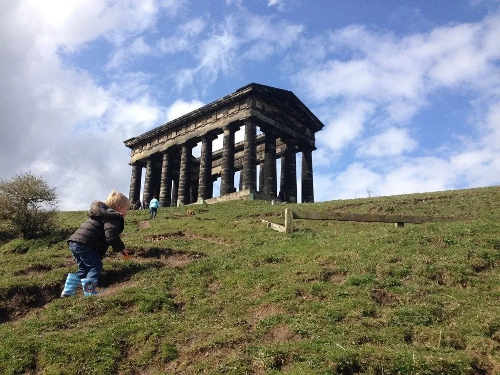 A family exploring Penshaw Monument, a National Trust estate in the North East