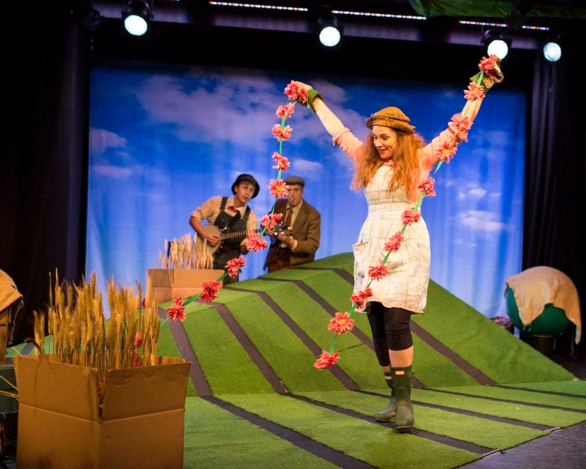 Dancing with flowers The Scarecrow's Wedding www.minitravellers.co.uk