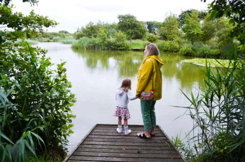 Family looking out over a lake. Part of my guide on Family Friendly Alternatives to Center Parcs