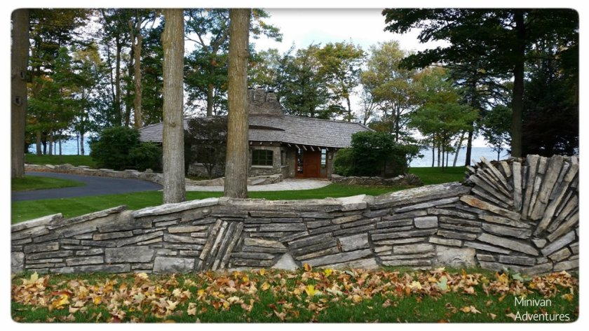 The Sucher House is accented by beautiful lake views and a charming limestone fence.
