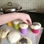 putting poppyseeds on bread dough