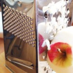 Grate the apple down to the core
