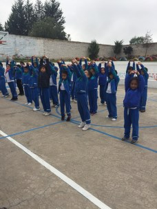 """The students outside before class during """"Brain Gym,"""" the time where we get ready for classes by stretching and practicing English and French!"""