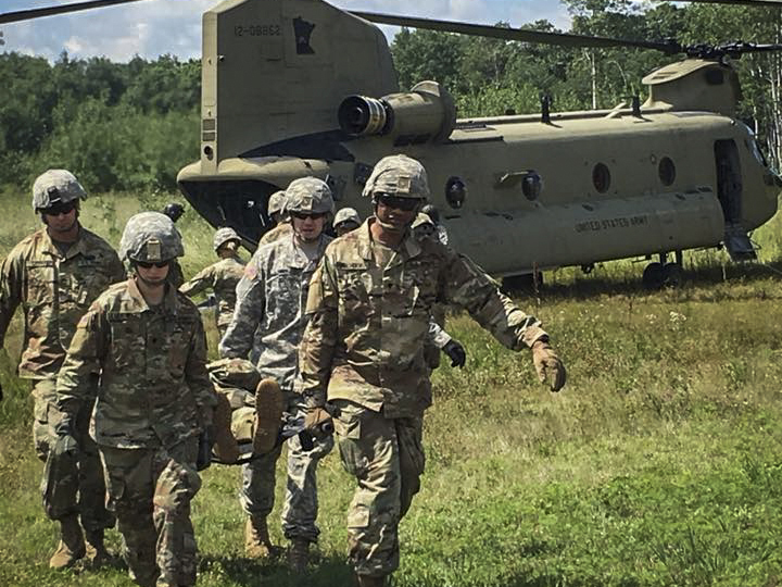 Soldiers of the 204th Medical Company Area Support train on patient evacuation during annual training at Camp Ripley on July 23, 2018.