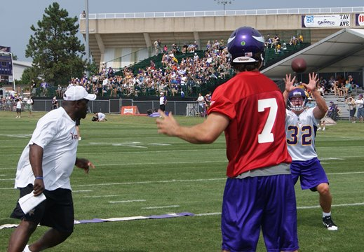 Photo of Christian Ponder throwing a pass to Toby Gerhart during training camp
