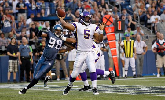 Photograph of Donovan McNabb throwing a pass against the Seattle Seahawks