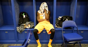 Tennessee guard Antonio Barton looks down in the locker room after his team lost its NCAA Midwest Regional semifinal college basketball tournament game to Michigan March 28. (AP photo: Michael Conroy)