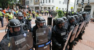 """Virginia State Police cordon off an area around the site where a car ran into a group of counterprotesters, killing one, after a white nationalist rally Aug. 12 in Charlottesville, Virginia. Columnist Noah Feldman writes, """"The bottom line is that the First Amendment allows and must allow the police to keep the peace."""" (AP photo)"""