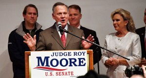 U.S. Senate candidate Roy Moore speaks as his wife, Kayla Moore, looks on at the end of an election-night watch party Tuesday in Montgomery, Alabama. (AP photo)