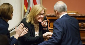 Lt. Gov./Senate President Michelle Fischbach jokes with Gov. Mark Dayton as he is introduced for his final State of the State address March 14 in the Minnesota State Capitol. (AP photo: Star Tribune)