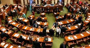 Representatives gather on the floor of the Minnesota House on Friday, May 24, on the opening day of a special session to finish work on the state's $48 billion two-year budget. (AP photo: Steve Karnowski)