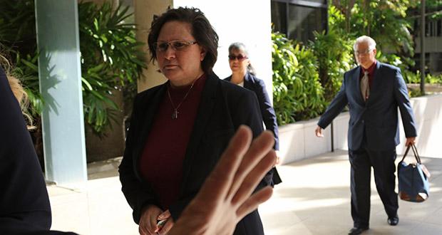 In this May 22, 2019, file photo, former Honolulu deputy city prosecutor Katherine Kealoha, left, and her husband, ex-police chief Louis Kealoha, right, walk into federal court in Honolulu. (AP Photo/Caleb Jones, File)