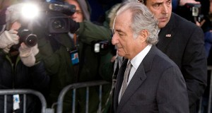 Bernard Madoff, founder of Bernard L. Madoff Investment Securities LLC, is escorted into federal court in New York on March 12, 2009. (Bloomberg file photo)