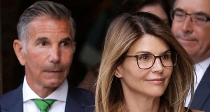 "One example of potentially disqualifying conflicts cited in the Varsity Blues scandal was the fact that Latham & Watkins represents ""Full House"" actress Lori Loughlin, her husband, fashion designer Mossimo Giannulli, and the University of Southern California — the school they are charged with defrauding. In this photo, Loughlin, front, and Giannulli, left, depart federal court in Boston on April 3 after facing charges in the college admissions bribery scandal. (AP file photo)"