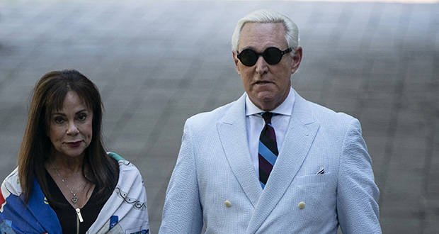 Roger Stone, a longtime confidant of President Donald Trump, accompanied by his wife, Nydia Stone, leaves federal court in Washington. (Bloomberg photo)