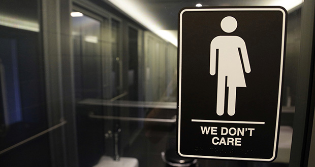 Signage hangs outside a restroom at 21c Museum Hotel in Durham, N.C., in this 2016 file photo. A federal judge approved a legal settlement Tuesday affirming transgender people's right to use restrooms matching their gender identity in many North Carolina public buildings. (AP file photo)