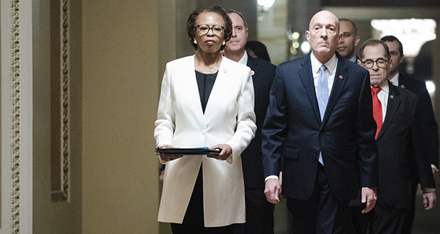 House Sergeant at Arms Paul Irving and Clerk of the House Cheryl Johnson deliver the articles of impeachment against President Donald Trump to the Senate on Jan. 15 on Capitol Hill in Washington. Following them are the impeachment managers appointed by the House of Representatives. (AP photo)