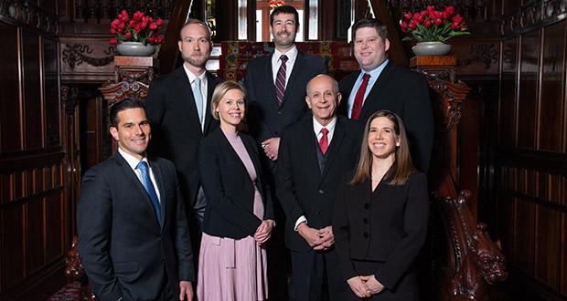 Bottom row: Keala Ede, Kirsi Poupore, Al Gilbert, Kathryn Iverson Landrum. Top row: Adam Welle, Thomas Madison, Jason Pleggenkuhle