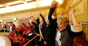 Equal Rights Amendment supporter Donna Granski, right, from Midlothian Virginia, cheers the passage of the House ERA Resolution in the Senate chamber at the Virginia Capitol in Richmond on Jan. 27. (AP photo)