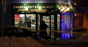 Police examine the interior of the Seward Market and Halal Meat in south Minneapolis after a triple homicide Jan. 6, 2010. (AP file photo: Star Tribune)