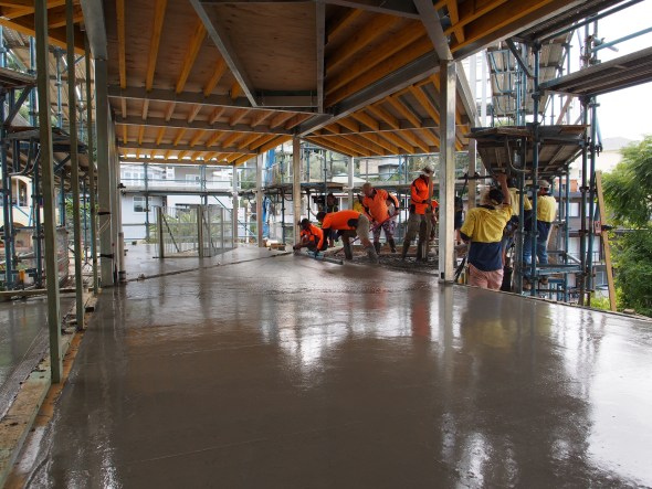 The suspended slab being poured on the lower floor.