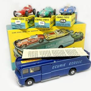 Corgi Gift Set No. 16 Ecurie Ecosse Racing Car Transporter This is a superb example of the Corgi Gift Set No.16 Ecurie Ecosse Racing Car Transporter with 3 Racing Cars. The set contains No.1126 Car Transporter in dark metallic blue with a yellow interior. The sliding door and loading mechanism both work as they should. Inside you will find the vice on the workbench. It is in wonderful condition and most would say its in mint condition, it still has the track rod steering sticker applied to the front roof which is rarely present. As usual it comes with three racing cars, No.150S Vanwall Formula 1 Grand Prix Car in red, white driver and racing number 25, the self-adhesive wire spoke transfers have been applied. The 151A Lotus Mk.XI Le Mans Racing Car in blue with red seats and white driver, racing number 3 is also in excellent condition. Finally No.152S BRM Formula 1 Grand Prix Racing Car in green with the Union Flag to bonnet and racing number 1, again the wire spoke transfers have been applied. All have flat cast hubs, all are excellent plus to near Mint with excellent plus to near mint yellow and blue card boxes. The main box is in wonderful condition and one of the best I have seen for a very long time. It comes with the internal packing piece as well as the original gift set instructions. A very fine example of this sought after set.
