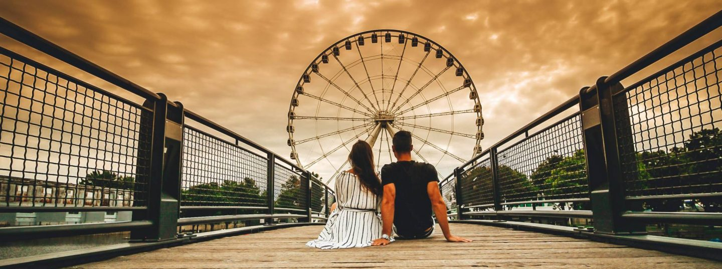 Travel couple photography in Montreal Ferris Wheel by danandnatty