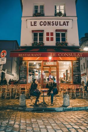 Couple at cafe restaurant le consulat in Paris
