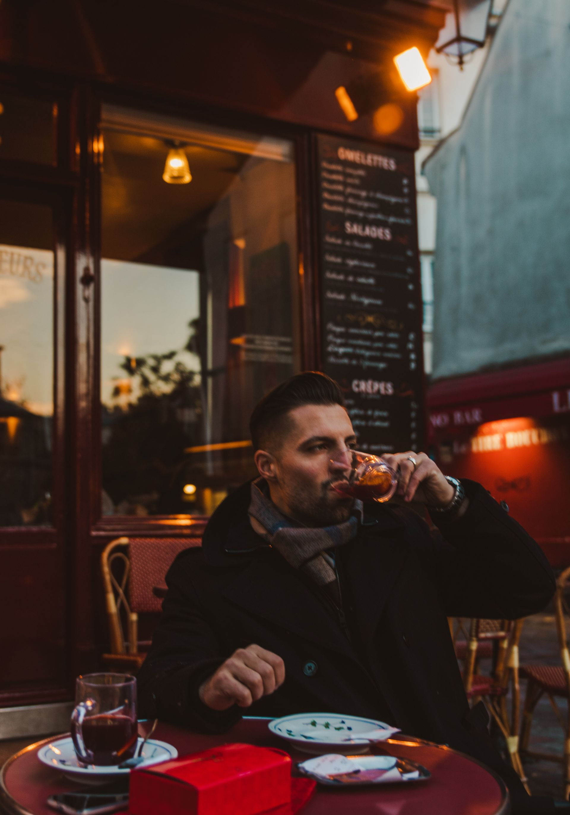 Dan Drinking Mulled Wine at Le Consulat in Paris France