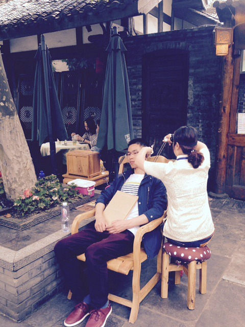 China: Ear Cleaning down a Chengdu alley way. #ThisisChina