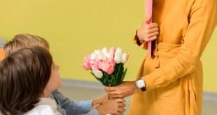 children giving their teacher bouquet flowers 23 2148668542