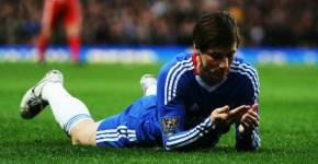 Fernando Torres, Chelsea. Sad and reading.