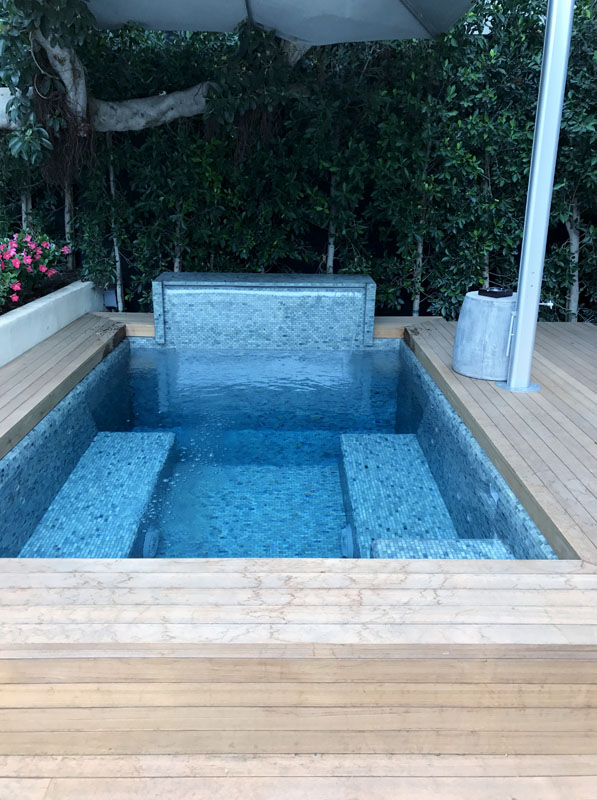 Glass tile spa with cold plunge and waterfall 2