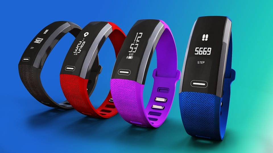 Image of classic fitness trackers like the FitBit in different colors