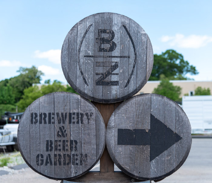 Barrels used as signage directing people to the Barrel House Z brewery and beer garden