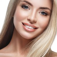 Healthy skin woman face looking camera with blond long hair