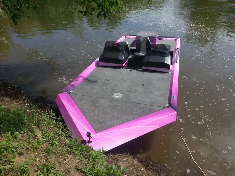 pink boat on a lake