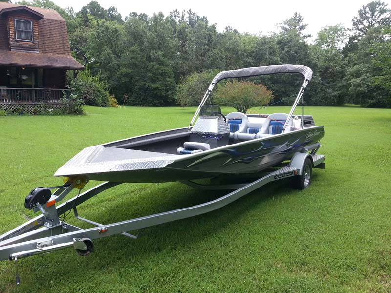 shoal runner black and silver boat on trailer