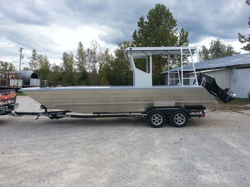 silver boat on trailer side view