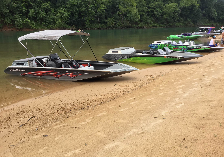 line of boats on a sandbar