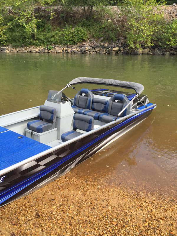 blue boat on sandbar