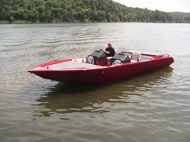red boat on a lake